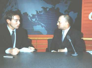 warren edwardes being interviewed in derivatives on arirang television korea